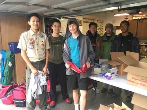 jp and friends in garage with survival supplies