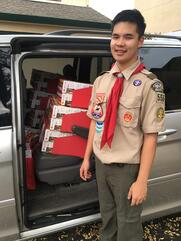JP stands in his scout uniform