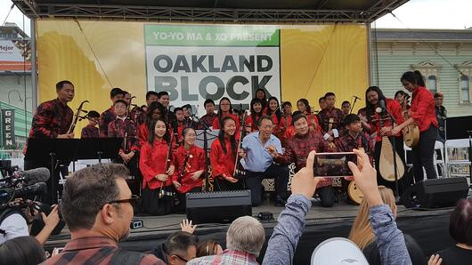 The Laney Chinese Orchestra takes a pictures with Yo-Yo Ma at a music festival.