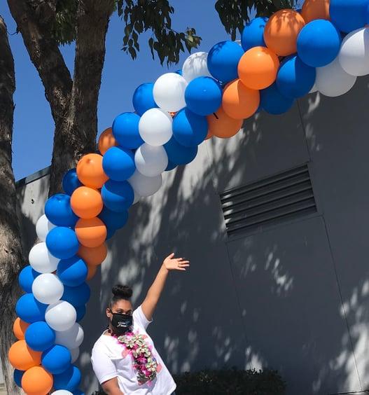 Qiara Houston with an SJND-themed balloon arch.