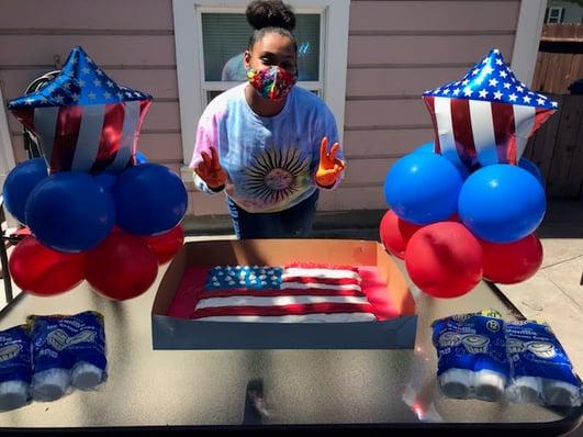 Qiara Houston with her American flag cake.