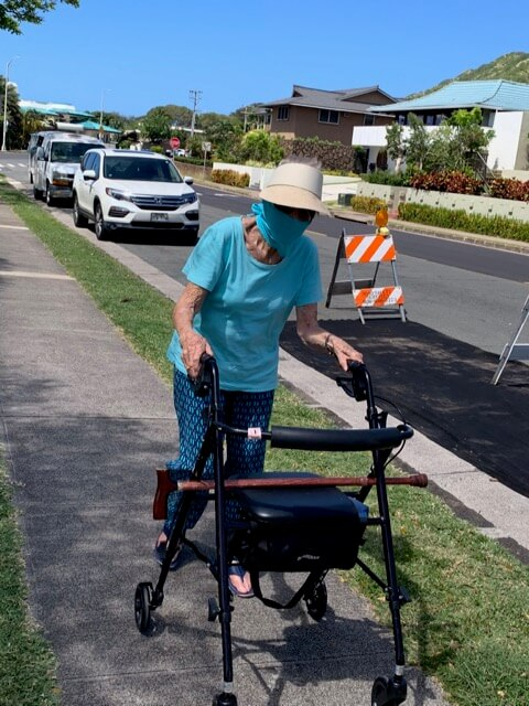Violet Golden, SJND '39, uses her walker to stroll around her neighborhood during the pandemic.